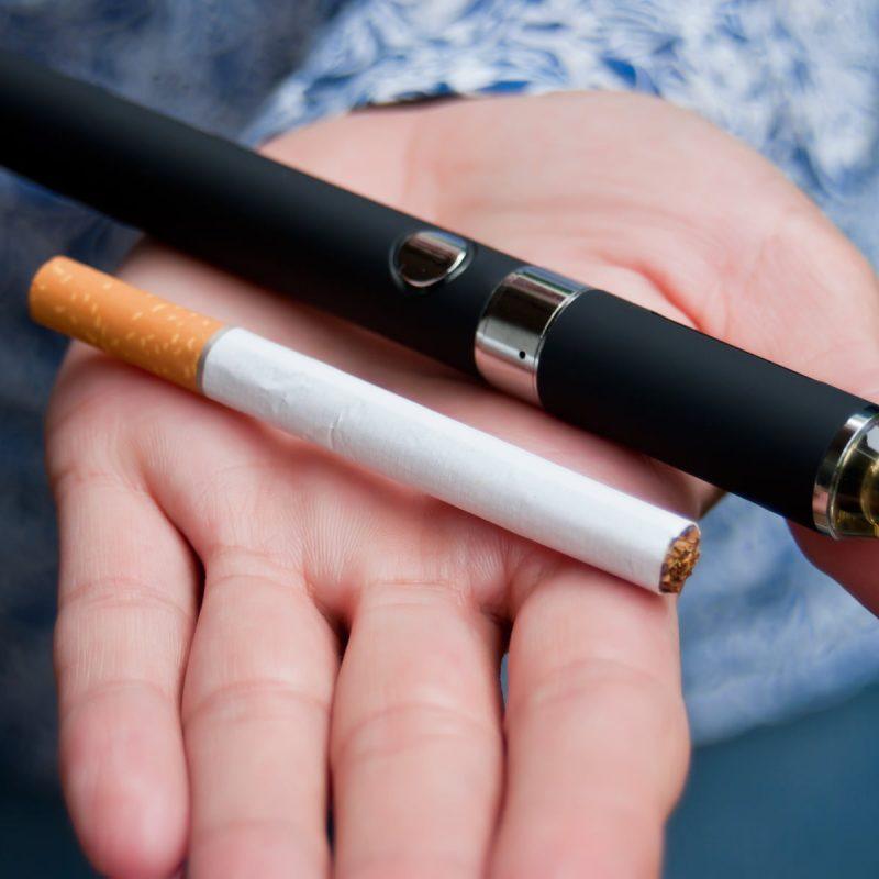 photo of e-cigarettes in someone's hand